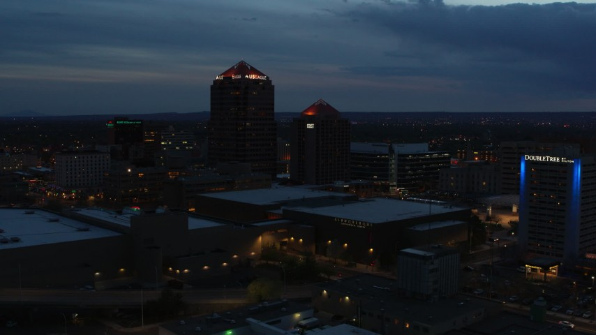 5.7K stock footage aerial video orbit office high-rise, hotel and Kiva Auditorium at twilight, Downtown Albuquerque, New Mexico Aerial Stock Footage | DX0002_128_026