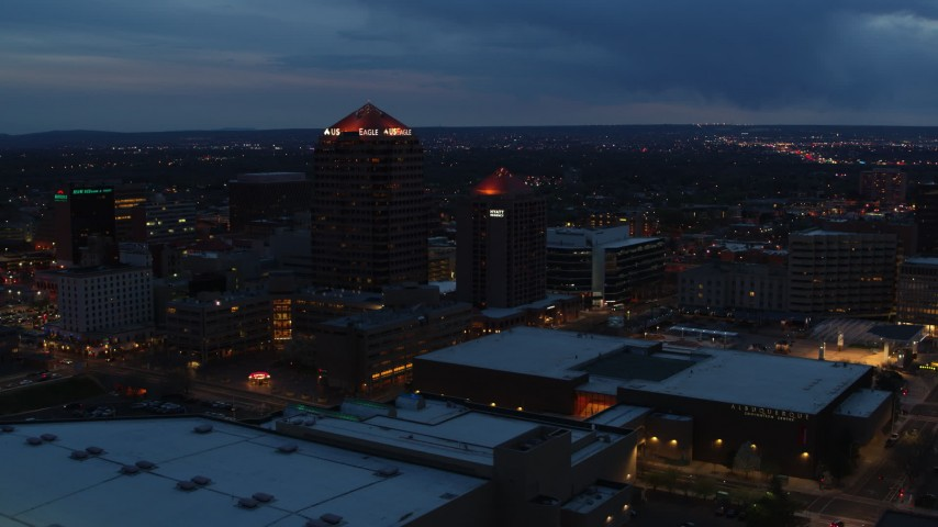 5.7K stock footage aerial video ascend with view of office high-rise, hotel and Kiva Auditorium at twilight, Downtown Albuquerque, New Mexico Aerial Stock Footage | DX0002_128_027