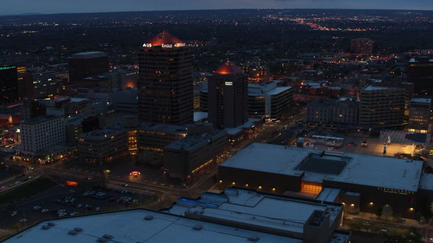 5.7K stock footage aerial video slow orbit of office high-rise, hotel and Kiva Auditorium at twilight, Downtown Albuquerque, New Mexico Aerial Stock Footage | DX0002_128_028