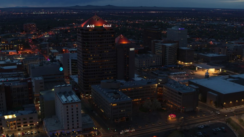 5.7K stock footage aerial video of an orbit of office high-rise and hotel at twilight, Downtown Albuquerque, New Mexico Aerial Stock Footage | DX0002_128_030
