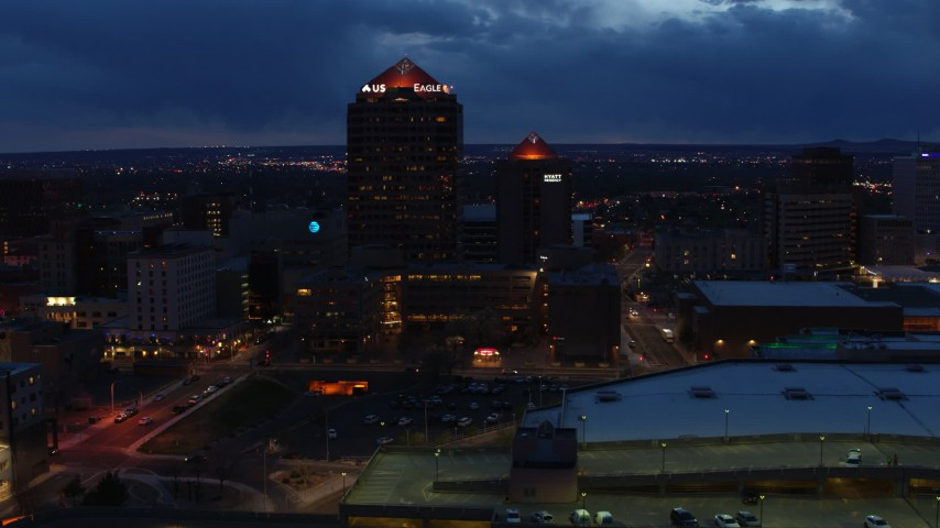 5.7K stock footage aerial video circling office high-rise beside hotel at twilight, Downtown Albuquerque, New Mexico Aerial Stock Footage | DX0002_128_034