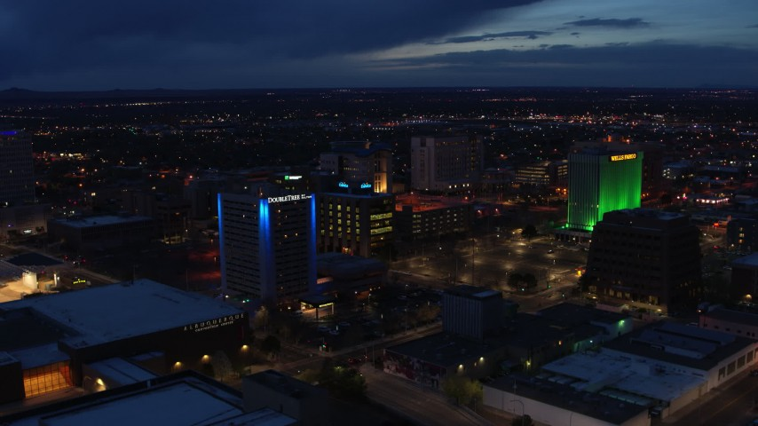 5.7K stock footage aerial video fly away from hotel and office buildings at twilight, Downtown Albuquerque, New Mexico Aerial Stock Footage | DX0002_128_036