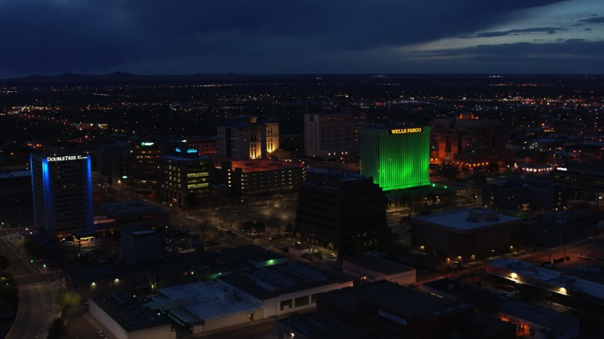5.7K stock footage aerial video flyby hotel and office buildings, approach Wells Fargo Building at twilight, Downtown Albuquerque, New Mexico Aerial Stock Footage | DX0002_128_037