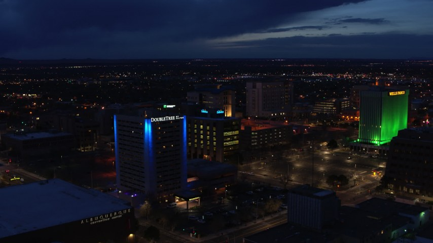 5.7K stock footage aerial video fly away from office buildings, reveal hotel at twilight, Downtown Albuquerque, New Mexico Aerial Stock Footage | DX0002_128_039
