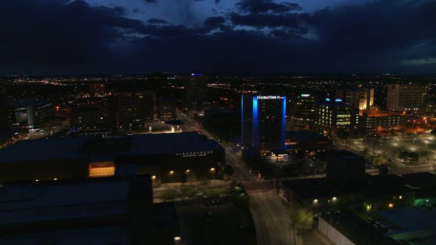 5.7K stock footage aerial video flyby auditorium, hotel and reveal office building at twilight, Downtown Albuquerque, New Mexico Aerial Stock Footage | DX0002_128_042