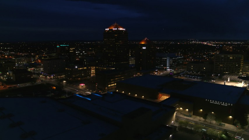 5.7K stock footage aerial video orbiting office high-rise beside hotel at twilight, reveal auditorium, Downtown Albuquerque, New Mexico Aerial Stock Footage | DX0002_128_044