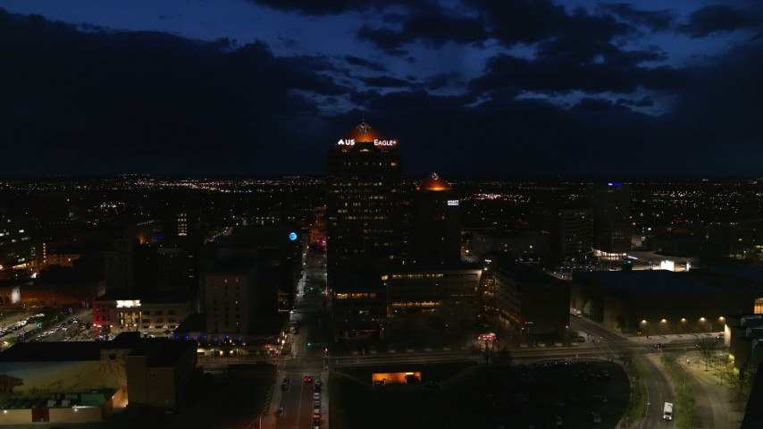5.7K stock footage aerial video circling an office high-rise and hotel at twilight, Downtown Albuquerque, New Mexico Aerial Stock Footage | DX0002_128_048