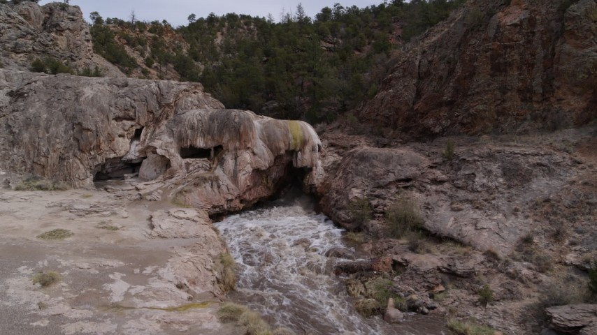 5.7K stock footage aerial video of an orbit of river rapids flowing through a rock formation in the mountains in New Mexico Aerial Stock Footage   DX0002_129_003