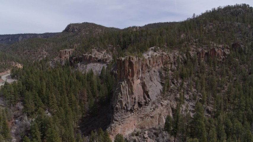 5.7K stock footage aerial video of circling around the end of a rock formation jutting from a mountain in New Mexico Aerial Stock Footage | DX0002_129_013