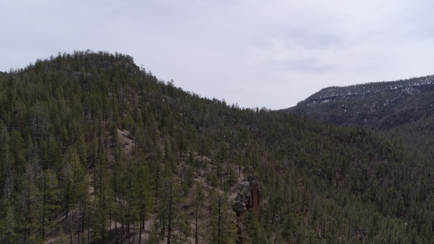 5.7K stock footage aerial video reverse view of a mountain covered with trees in New Mexico Aerial Stock Footage | DX0002_129_015