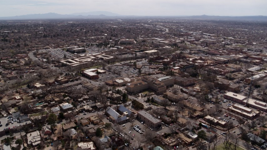 5.7K stock footage aerial video flying by the downtown area of Santa Fe, New Mexico Aerial Stock Footage | DX0002_129_018
