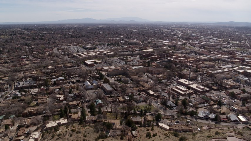 5.7K stock footage aerial video reverse view and orbit of the downtown area of Santa Fe, New Mexico Aerial Stock Footage   DX0002_129_019
