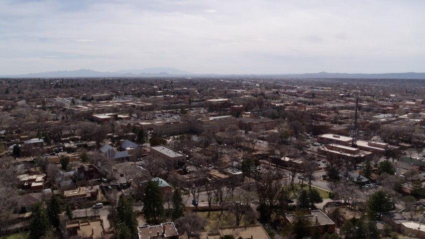 5.7K stock footage aerial video flying by the downtown area and surrounding city of Santa Fe, New Mexico Aerial Stock Footage | DX0002_129_023