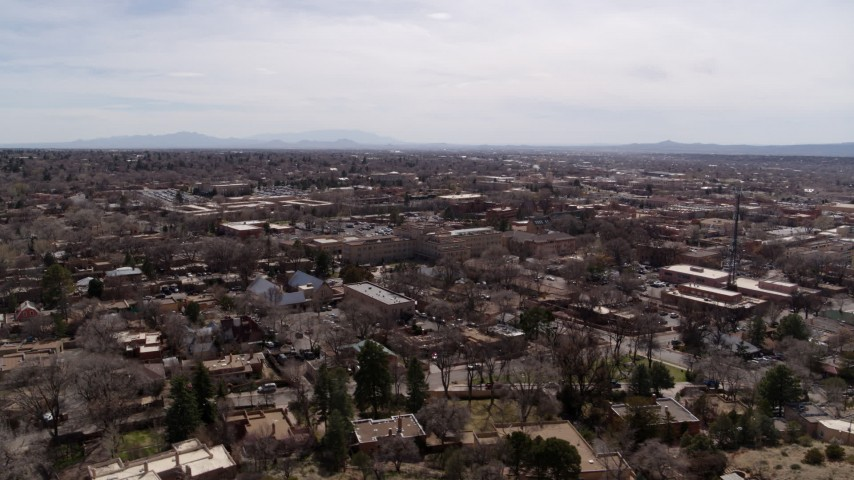 5.7K stock footage aerial video ascend and flyby the downtown area and surrounding city of Santa Fe, New Mexico Aerial Stock Footage   DX0002_129_024