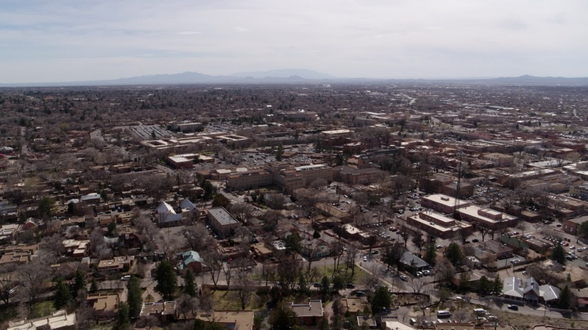 5.7K stock footage aerial video wide orbit around the downtown area, with view of surrounding city of Santa Fe, New Mexico Aerial Stock Footage | DX0002_129_025