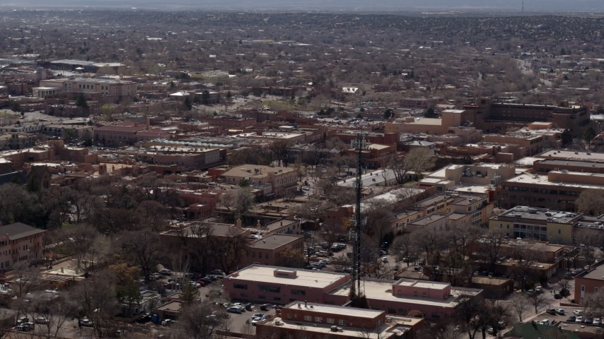 5.7K stock footage aerial video flying by Radio Plaza in the city's downtown area, Santa Fe, New Mexico Aerial Stock Footage | DX0002_129_030