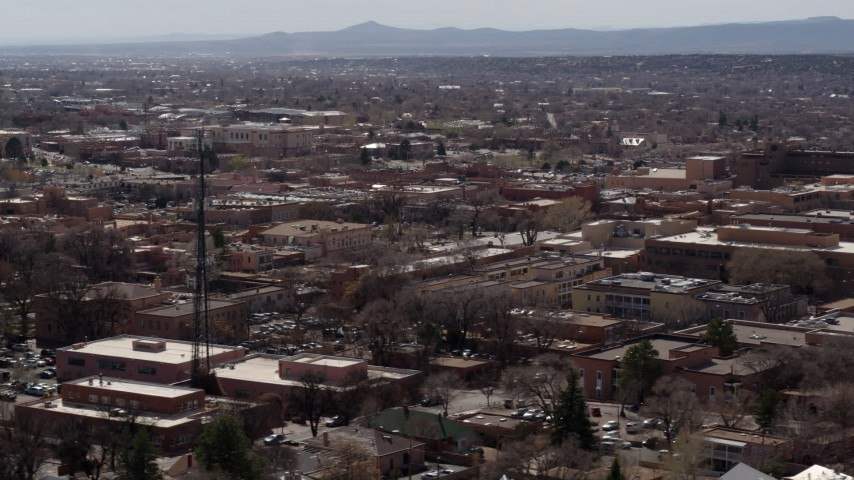 5.7K stock footage aerial video flyby Radio Plaza, ascend for view of the city's downtown area, Santa Fe, New Mexico Aerial Stock Footage | DX0002_129_033