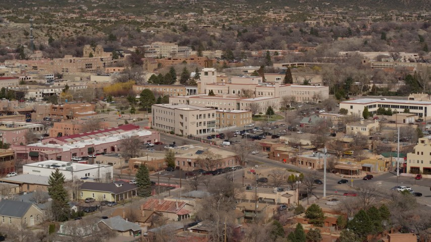 5.7K stock footage aerial video reverse view of state government buildings in the city's downtown area, Santa Fe, New Mexico Aerial Stock Footage DX0002_129_037   Axiom Images