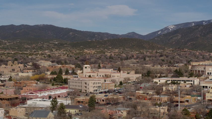 5.7K stock footage aerial video of passing by Bataan Memorial Building near capitol building, Santa Fe, New Mexico Aerial Stock Footage   DX0002_129_044