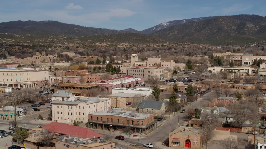 5.7K stock footage aerial video focus on Bataan Memorial Building near capitol building, flyby shops, Santa Fe, New Mexico Aerial Stock Footage   DX0002_130_001