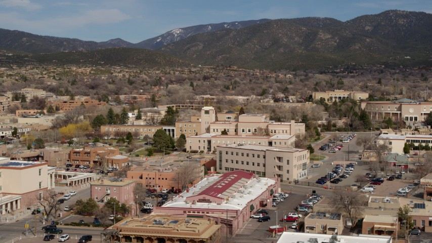 5.7K stock footage aerial video fly away from Bataan Memorial Building near capitol, Santa Fe, New Mexico Aerial Stock Footage | DX0002_130_006