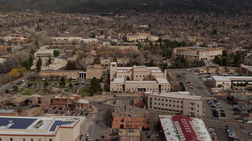 5.7K stock footage aerial video fly away from Bataan Memorial Building and state capitol building, Santa Fe, New Mexico Aerial Stock Footage | DX0002_130_008