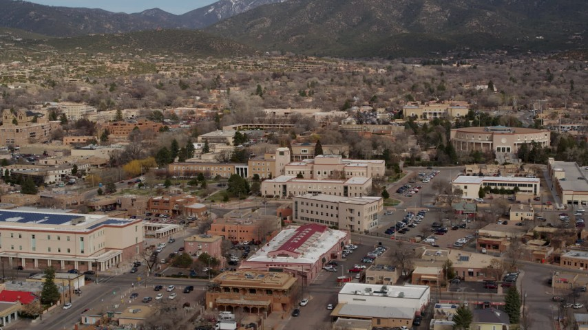 5.7K stock footage aerial video descend and focus on Bataan Memorial Building near state capitol building, Santa Fe, New Mexico Aerial Stock Footage   DX0002_130_009