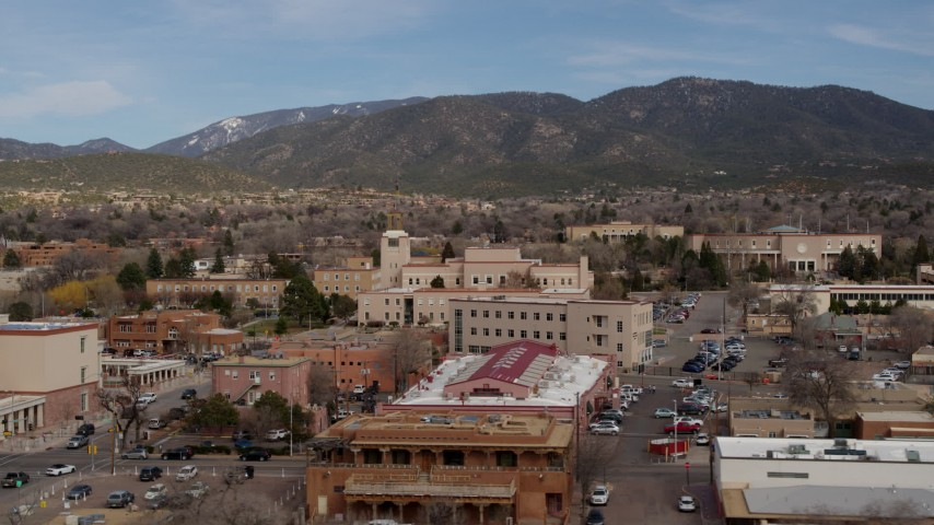 5.7K stock footage aerial video orbit Bataan Memorial Building, state capitol in background, Santa Fe, New Mexico Aerial Stock Footage | DX0002_130_010