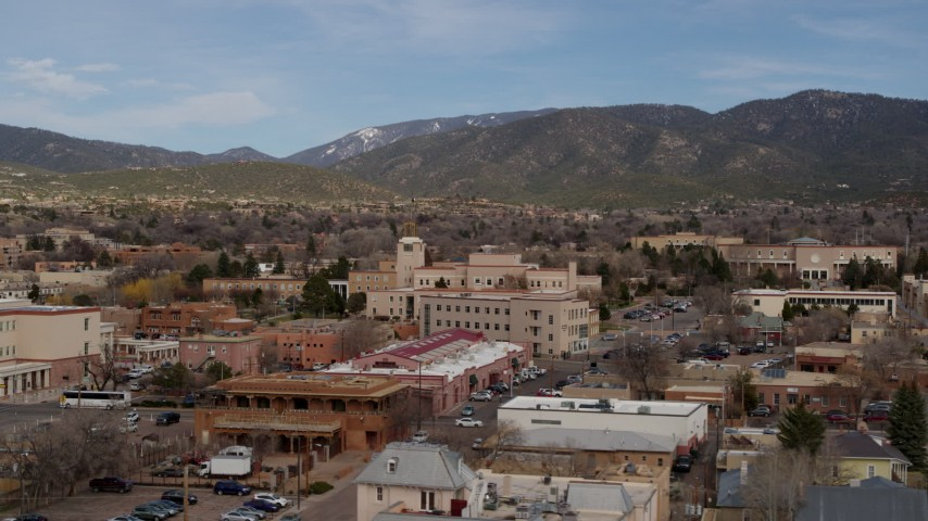 5.7K stock footage aerial video an orbit of state government offices and shops, state capitol in background, Santa Fe, New Mexico Aerial Stock Footage | DX0002_130_011