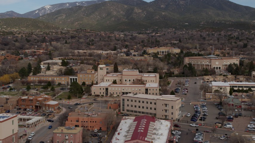 5.7K stock footage aerial video ascend while focused on Bataan Memorial Building near the state capitol in Santa Fe, New Mexico Aerial Stock Footage   DX0002_130_015