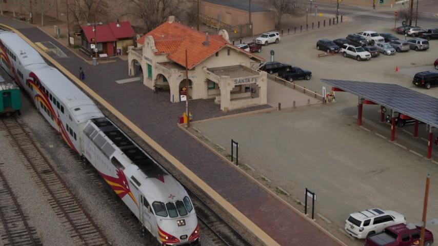 5.7K stock footage aerial video orbit passenger train at the station in Santa Fe, New Mexico, tilt to top of the train Aerial Stock Footage   DX0002_130_018