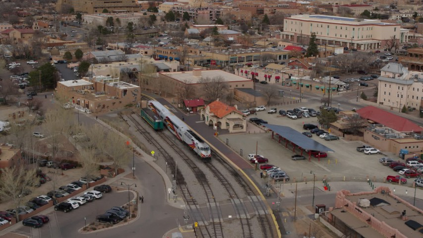 5.7K stock footage aerial video fly away from passenger train at the station in Santa Fe, New Mexico, tilt to top of the train Aerial Stock Footage | DX0002_130_019