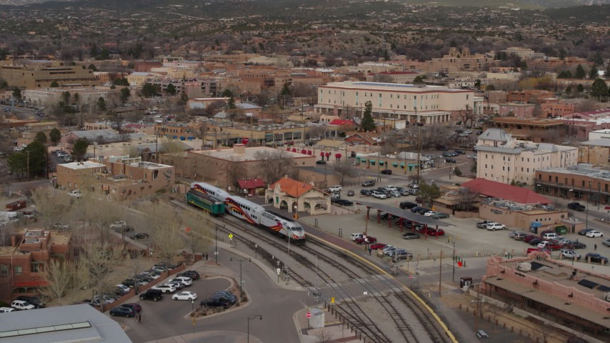 5.7K stock footage aerial video circling a passenger train at a station in Santa Fe, New Mexico, tilt to top of the train Aerial Stock Footage   DX0002_130_020