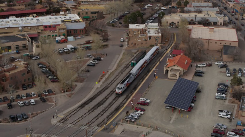 5.7K stock footage aerial video fly away from bird's eye of a passenger train at a station in Santa Fe, New Mexico, tilt to top of the train Aerial Stock Footage | DX0002_130_021