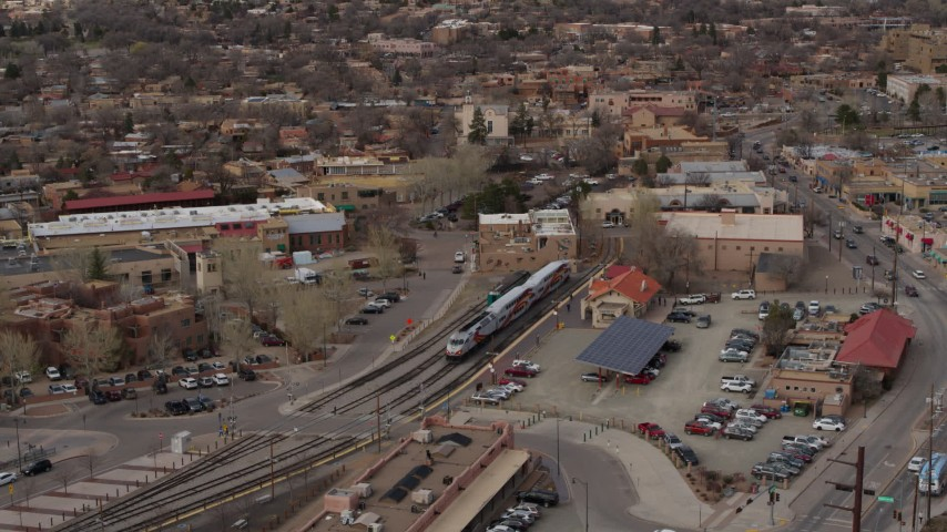 5.7K stock footage aerial video fly around a passenger train at a station in Santa Fe, New Mexico, tilt to top of the train Aerial Stock Footage | DX0002_130_022