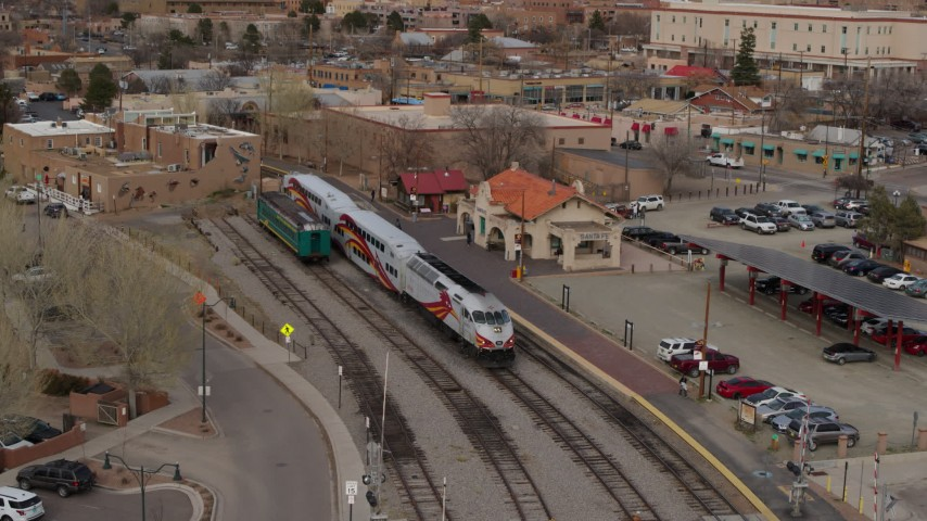 5.7K stock footage aerial video descend near a passenger train at a station in Santa Fe, New Mexico Aerial Stock Footage | DX0002_130_024