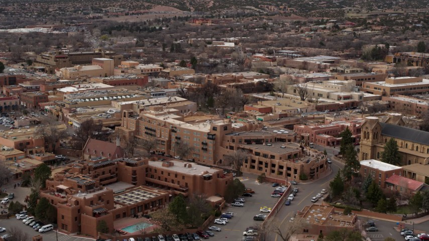 5.7K stock footage aerial video of a reverse view of two hotels in Santa Fe, New Mexico Aerial Stock Footage   DX0002_130_026