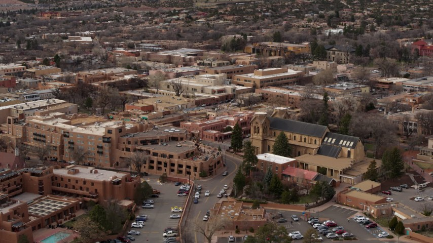 5.7K stock footage aerial video approach a hotel and a cathedral in Santa Fe, New Mexico Aerial Stock Footage DX0002_130_031 | Axiom Images