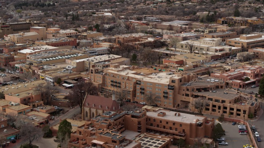 5.7K stock footage aerial video descend past two hotels in Santa Fe, New Mexico Aerial Stock Footage | DX0002_130_032