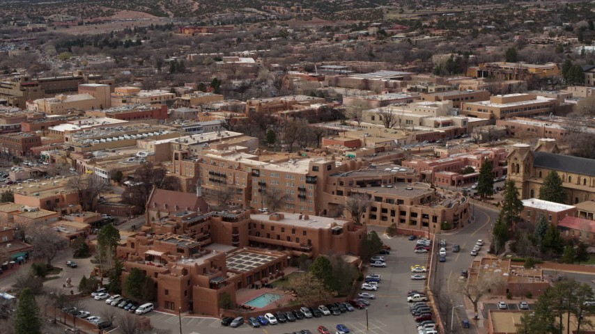 5.7K stock footage aerial video flyby hotels to reveal a cathedral in Santa Fe, New Mexico Aerial Stock Footage | DX0002_130_033