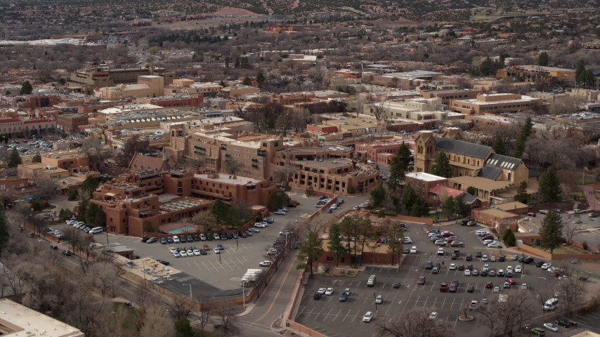 5.7K stock footage aerial video fly away from and by hotels and a cathedral in Santa Fe, New Mexico Aerial Stock Footage | DX0002_130_034