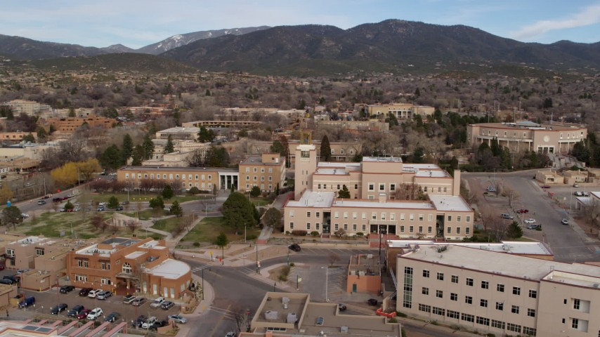 5.7K stock footage aerial video orbit the Bataan Memorial Building and reveal the capitol in Santa Fe, New Mexico Aerial Stock Footage | DX0002_131_005