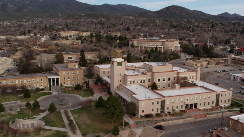 5.7K stock footage aerial video approach the Bataan Memorial Building, capitol in background in Santa Fe, New Mexico Aerial Stock Footage   DX0002_131_006