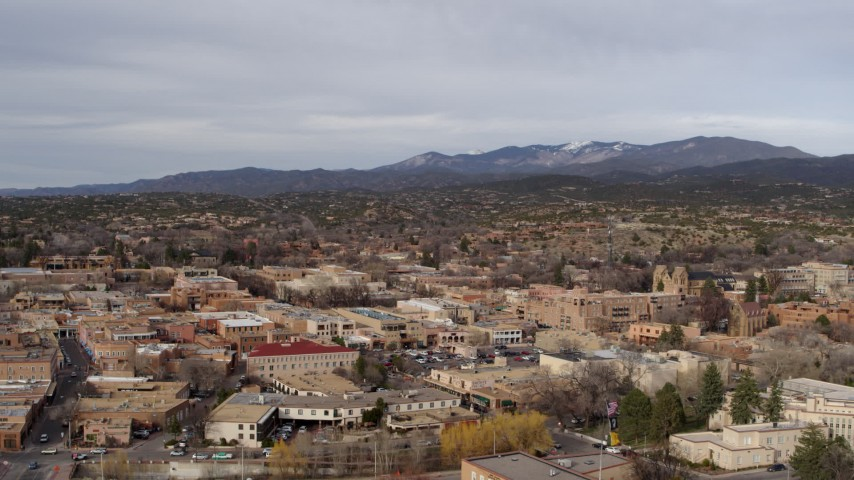 5.7K stock footage aerial video flyby and away from the downtown area of Santa Fe, New Mexico, reveal Bataan Memorial Building Aerial Stock Footage   DX0002_131_010