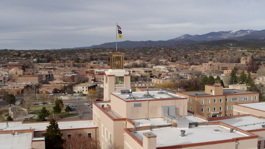 5.7K stock footage aerial video orbiting tower and flags on Bataan Memorial Building, Santa Fe, New Mexico Aerial Stock Footage | DX0002_131_011
