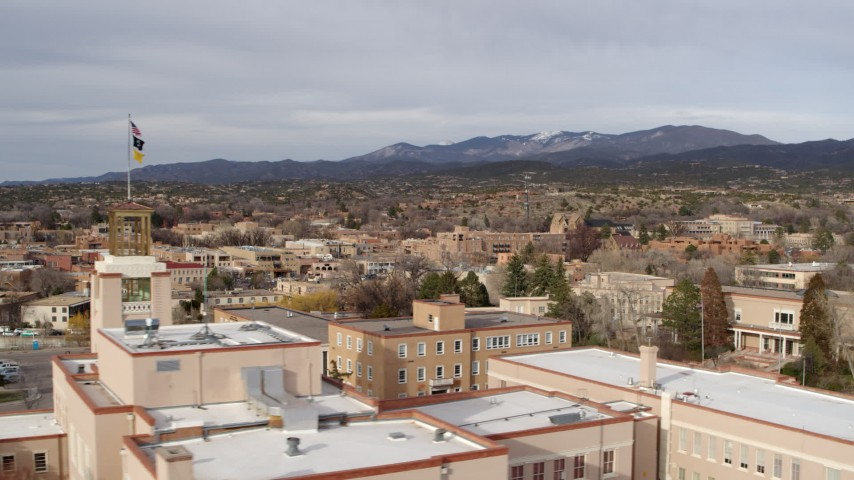 5.7K stock footage aerial video flyby downtown to reveal tower on Bataan Memorial Building, Santa Fe, New Mexico Aerial Stock Footage | DX0002_131_012