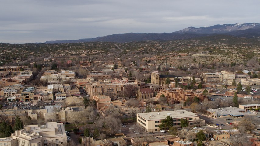 5.7K stock footage aerial video fly away from and past downtown area of Santa Fe, New Mexico Aerial Stock Footage | DX0002_131_014