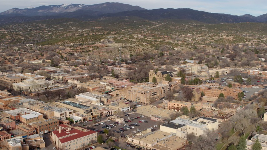 5.7K stock footage aerial video fly over downtown area of Santa Fe, New Mexico to approach cathedral Aerial Stock Footage | DX0002_131_016