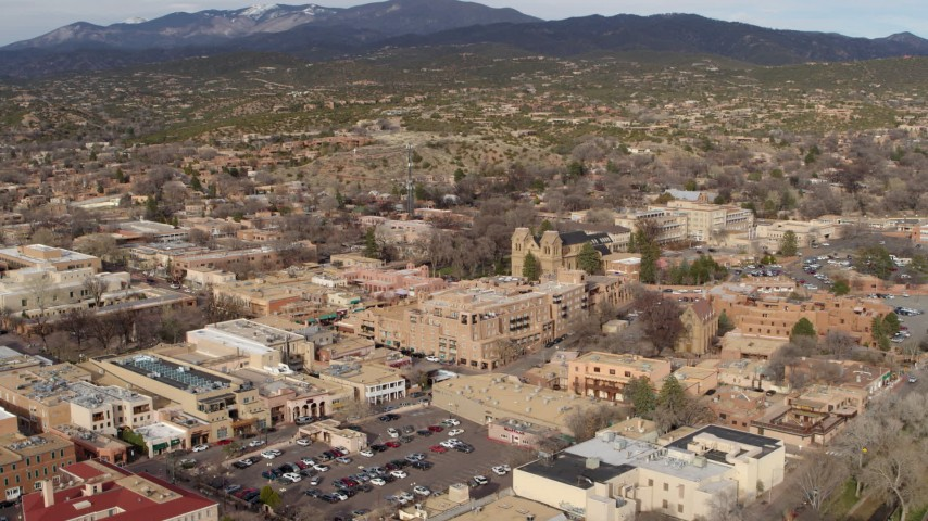 5.7K stock footage aerial video reverse view of cathedral and downtown, reveal Bataan Memorial Building, Santa Fe, New Mexico Aerial Stock Footage | DX0002_131_017