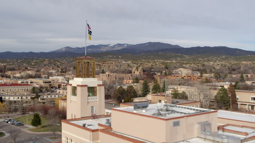 5.7K stock footage aerial video flyby Bataan Memorial Building to reveal downtown, Santa Fe, New Mexico Aerial Stock Footage | DX0002_131_018